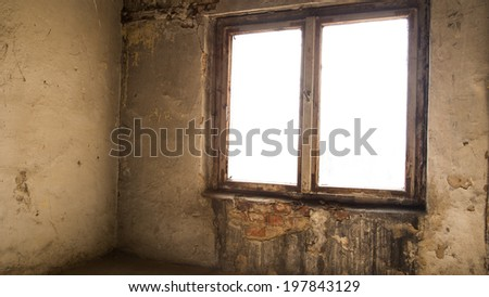 Abandoned room with dirty walls, dusty floor and damaged window - stock photo