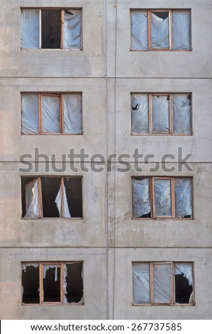 Abandoned ruined deserted house, windows without panes - stock photo