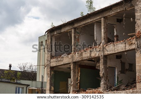 Abandoned ruined factory building - stock photo