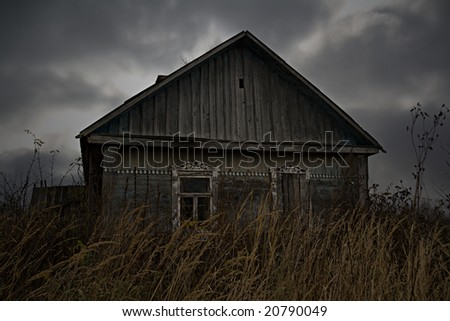 Abandoned rural house in Russian village. Gloomy scene.