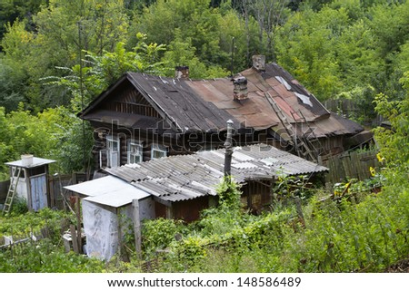 Abandoned rural wooden house amongst the trees in Murom