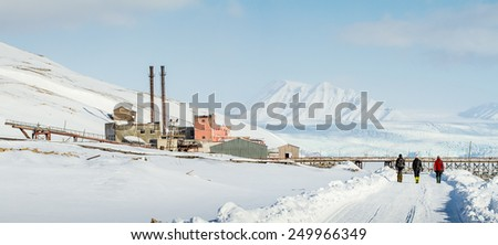 Abandoned Russian mining village of pyramiden svalbard norway with last coal car - stock photo
