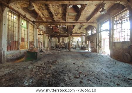 Abandoned rusty factory interior - stock photo
