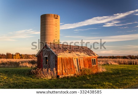Abandoned Shack And Silo. Abandoned shack and silo in America's Midwest. - stock photo