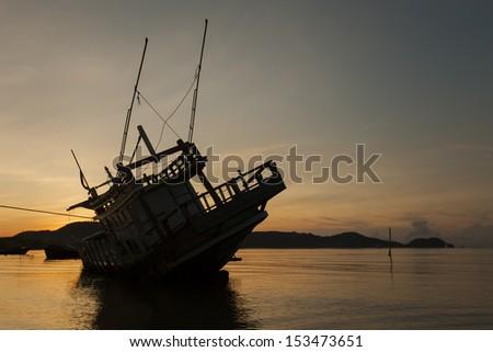 Abandoned ship with beautiful sky - stock photo