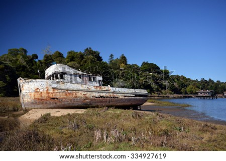 abandoned shipwreck on the bay - stock photo