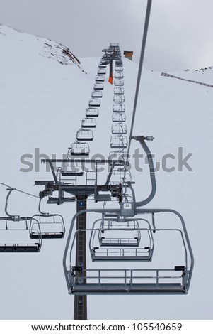 Abandoned ski lift in winter landscape - stock photo