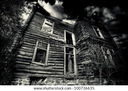 abandoned spooky house in black and white - stock photo