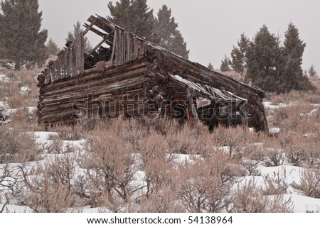 Abandoned structure on a hillside in a once prosperous mining town...now only a ghost town remains - stock photo