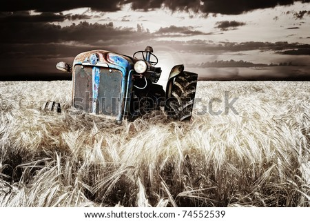 Abandoned tractor - stock photo
