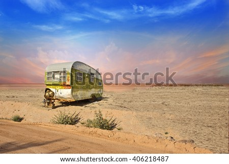 Abandoned Trailer in Desert Landscape