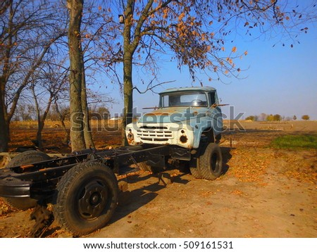 Abandoned truck on background of the field.