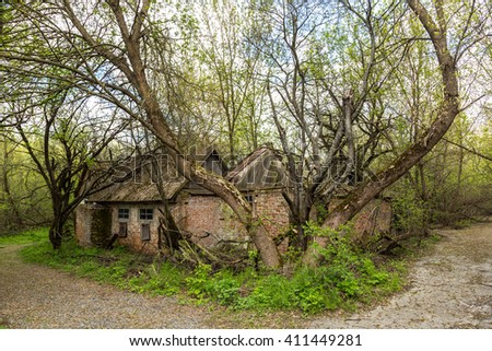 Abandoned village in Chernobyl, Ukraine in a summer day - stock photo