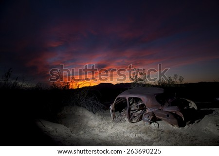 Abandoned vintage auto in the desert, with gorgeous sunset, Joshua Tree National Park - stock photo