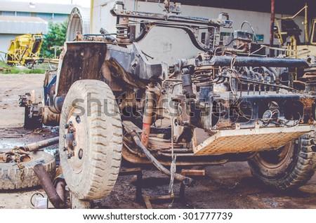 Abandoned vintage car - stock photo
