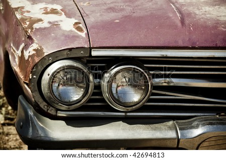 Abandoned vintage car, closeup on lights - stock photo