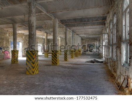 Abandoned warehouse with windows and post - stock photo