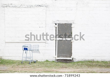 abandoned white wall with shopping cart