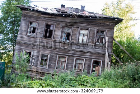 Abandoned wooden house in  Arkhangelsk, Russian northern city. Example of early XXth architecture.  - stock photo