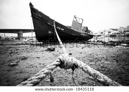 Abandoned wooden ship, still strapped. - stock photo