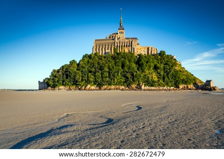 Abbey Mont Saint Michel at low tide Brittany, Basse, Normandy,  France, Europe - stock photo