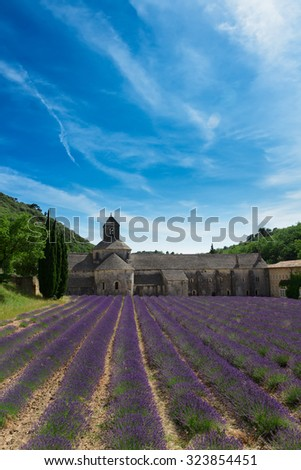 Abbey Senanque and blooming  Lavender field at summer day, France - stock photo