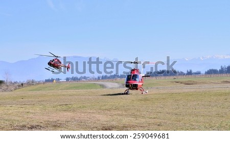 ABBOTSFORD, CANADA - MARCH 08: Aerobatic helicopter displays for civilian at the International Aerospace event on March 08, 2015 in Abbotsford, Canada.   - stock photo