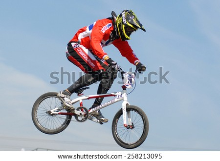 ABBOTSFORD, CANADA - SEPTEMBER 14, 2012: Riders compete at the UCI BMX Supercross World Cup 2012 in Abbotsford, Canada, on September 14, 2012. - stock photo
