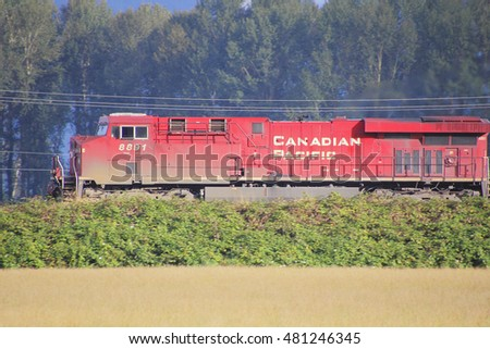 ABBOTSFORD - SEPTEMBER 9, 2016: The profile view of a red Canadian Pacific or CP locomotive traveling right to left on September 9, 2016 near Matsqui, British Columbia, Canada.