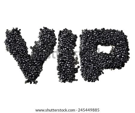 Abbreviation VIP made of black caviare - stock photo