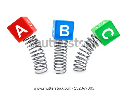 ABC cubes jumping with spring on a white background - stock photo