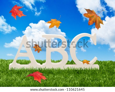 ABC letters with falling autumn leaves - back to school concept for autumn term - stock photo