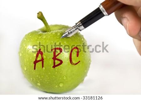 ABC on fresh green apple - stock photo