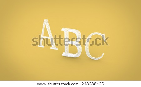 ABC rendering letters on a yellow background, closeup of photo