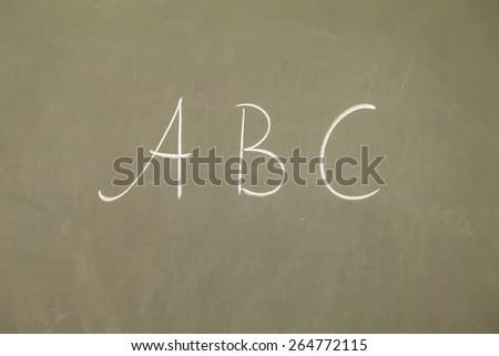 abc written on blackboard - stock photo