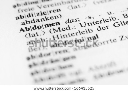 Abdomen - text and explanation in German language/Abdomen - stock photo