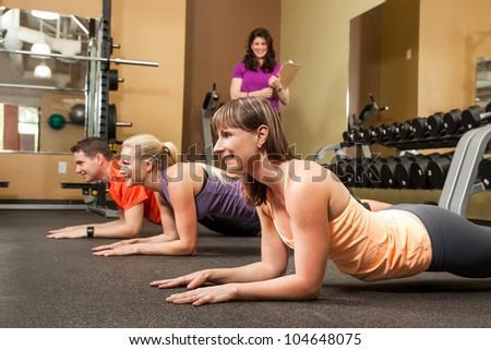 Abdominal Workout Performing Basic Plank Posture - stock photo