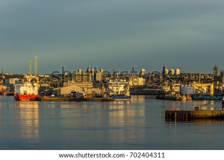 Aberdeen harbour, Scotland, United Kingdom, 16th August 2017. Aberdeen harbour and city at dawn with oil vessels at dock.