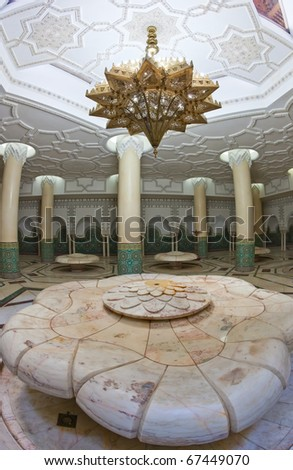 Ablution hall of the Mosque of Hassan II in Casablanca, Morocco. Believers wash and clean themselves here before saying their prayers. Fish-eye shot. - stock photo