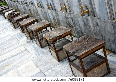 Ablution taps at a mosque in Istanbul where worshippers wash their feet. - stock photo