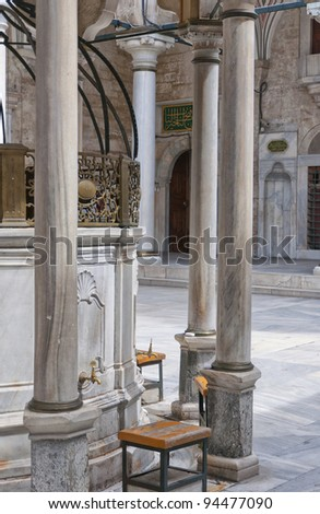Ablution taps at the Laleli mosque in Istanbul where worshippers wash their feet. - stock photo