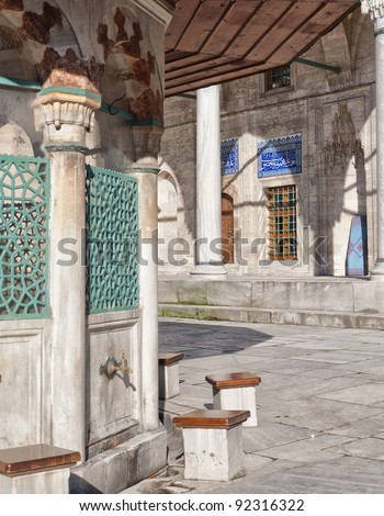 Ablution taps at the sokullu pasa camii mosque in Istanbul where worshippers wash their feet. - stock photo