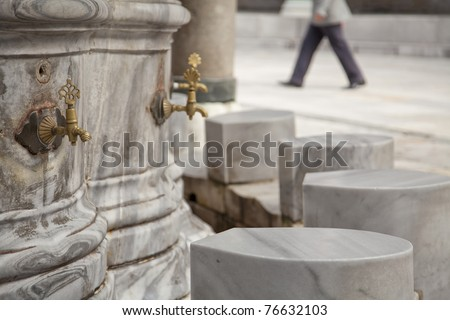 Ablution taps where worshippers wash their feet before prayer time. Beayazit mosque, Istanbul, Turkey. - stock photo
