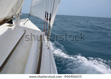 Aboard a sailboat on the sea - stock photo