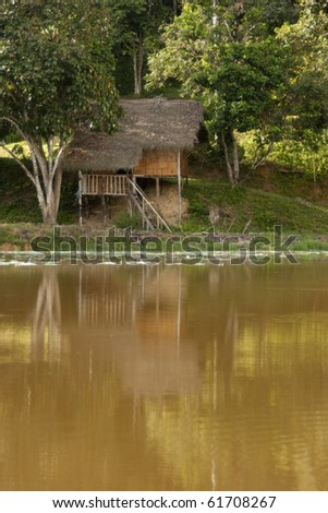 Aboriginal Hut by The River Banks in Tropical Jungle