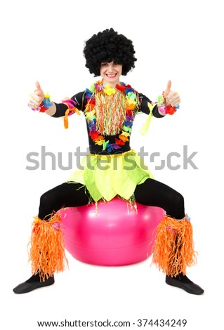 Aborigine woman sitting on fitness ball with thumb up on white background