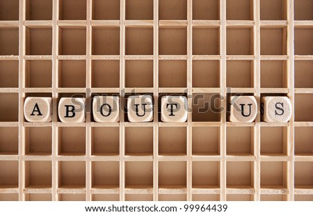 About us words construction with letter blocks / cubes and a shallow depth of field - stock photo