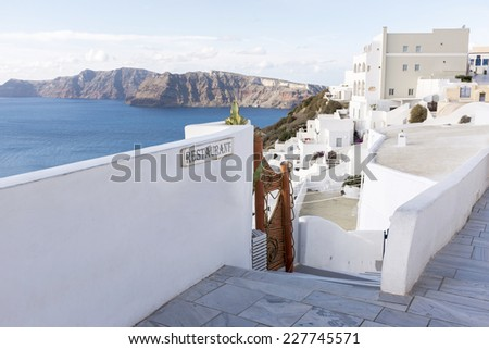 Above a restaurant in Oia village on Santorini in the Aegean Sea. Santorini is a popular tourist destination and belongs to the group of islands called the Cyclades in the Mediterranean.