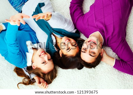Above angle of ecstatic friends looking at camera - stock photo