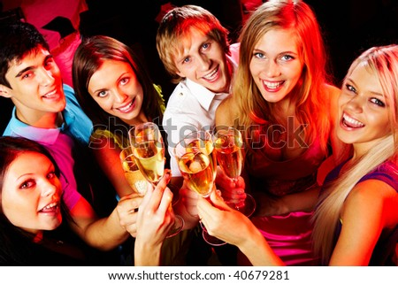 Above angle of group of friends enjoying themselves at party - stock photo